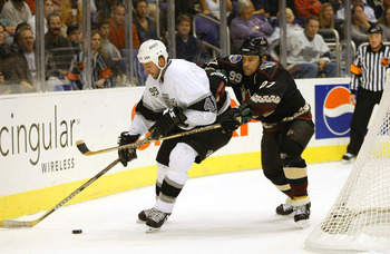 Numminen doing his job checking Los Angeles Kings forward Jason Allison.