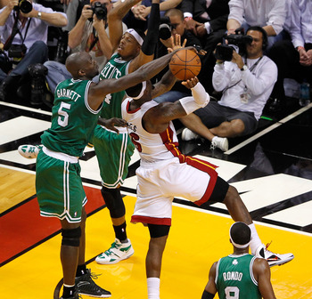MIAMI, FL - JUNE 05:  Kevin Garnett #5 of the Boston Celtics blocks a shot attempt by LeBron James #6 of the Miami Heat in the first half of Game Five of the Eastern Conference Finals in the 2012 NBA Playoffs on June 5, 2012 at American Airlines Arena in 
