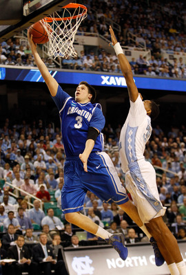 GREENSBORO, NC - MARCH 18:  Doug McDermott #3 of the Creighton Bluejays lays the ball up ahead of John Henson #31 of the North Carolina Tar Heels in the first half during the third round of the 2012 NCAA Men's Basketball Tournament at Greensboro Coliseum