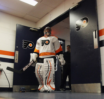 UNIONDALE, NY - NOVEMBER 23:  Ilya Bryzgalov #30 of the Philadelphia Flyers pauses before heading out ofr warmups prior to the game against the New York Islanders at the Nassau Veterans Memorial Coliseum on November 23, 2011 in Uniondale, New York.  (Phot