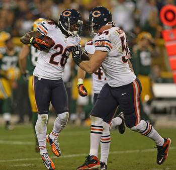 GREEN BAY, WI - SEPTEMBER 13:  Tim Jennings #26 of the Chicago Bears celebrates an interception with Brian Urlacher #54 against the Green Bay Packers at Lambeau Field on September 13, 2012 in Green Bay, Wisconsin. The Packers defeated the Bears 23-10.  (P