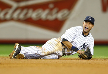 Derek Jeter grimmaces in pain after fracturing his ankle during the playoffs.