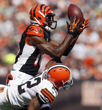 CLEVELAND, OH - OCTOBER 14:  Wide receiver A.J. Green #18 of the Cincinnati Bengals makes a catch over defensive back Buster Skrine #22 of the Cleveland Browns at Cleveland Browns Stadium on October 14, 2012 in Cleveland, Ohio.  (Photo by Matt Sullivan/Ge