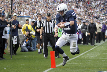 STATE COLLEGE, PA - OCTOBER 06:  Matthew McGloin #11 of the Penn State Nittany Lions scores a touchdown on a five yard run in the fourth quarter against the Northwestern Wildcats during the game on October 6, 2012 at Beaver Stadium in State College, Penns