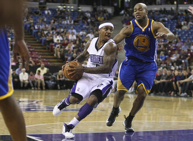 October 17, 2012; Sacramento, CA, USA; Sacramento Kings guard Isaiah Thomas (22) drives in against Golden State Warriors point guard Jarrett Jack (2) during the fourth quarter at Sleep Train Arena. The Golden State Warriors defeated the Sacramento Kings 9