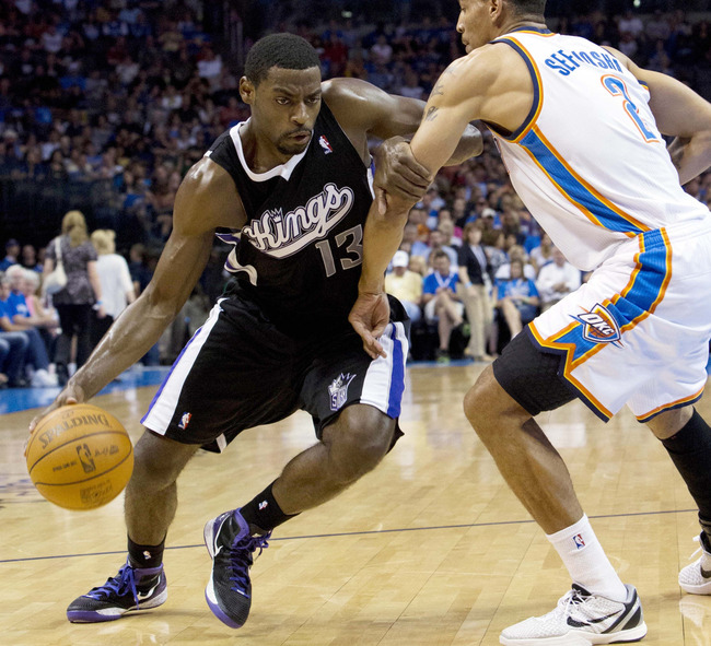 April 24, 2012; Oklahoma City  OK, USA; Sacramento Kings point guard Tyreke Evans (13) drives to the basket against Oklahoma City Thunder shooting guard Thabo Sefolosha (2) during the third quarter at Chesapeake Energy Arena. Mandatory Credit: Richard Row