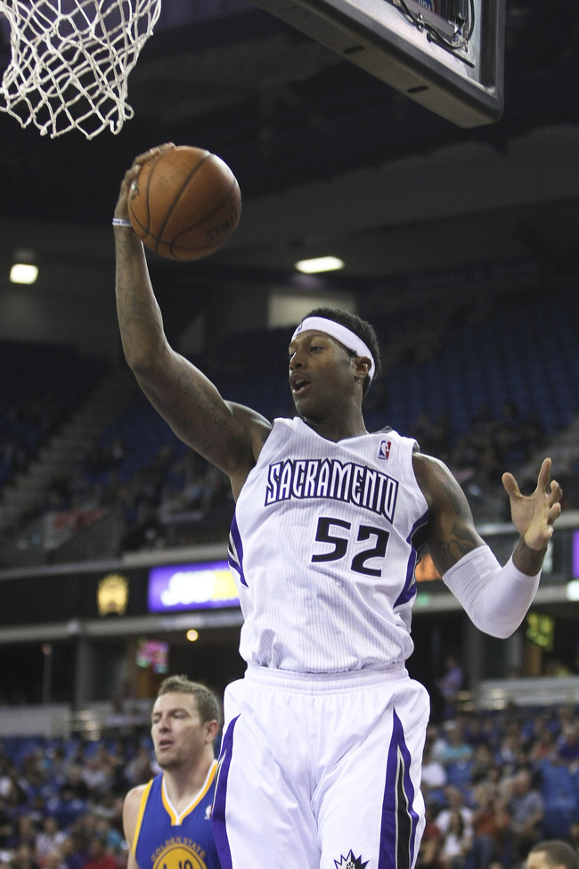 October 17, 2012; Sacramento, CA, USA; Sacramento Kings forward James Johnson (52) pull sin the rebound against the Golden State Warriors during the second quarter at Sleep Train Arena. Mandatory Credit: Kelley L Cox-US PRESSWIRE