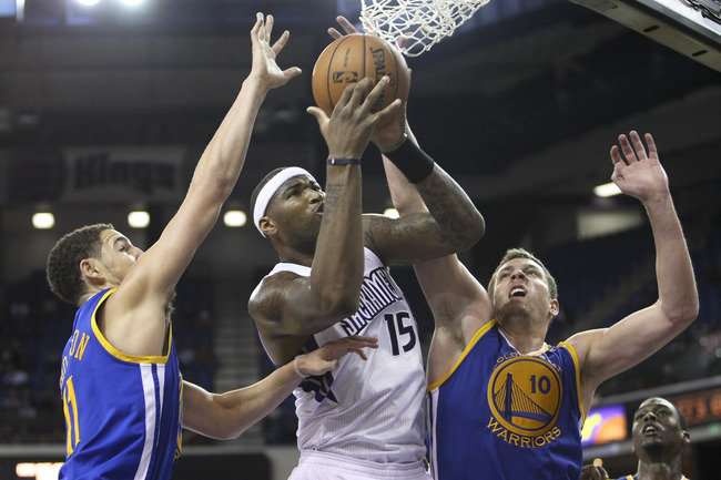 October 17, 2012; Sacramento, CA, USA; Sacramento Kings center DeMarcus Cousins (15) goes up for the basket between Golden State Warriors guard Klay Thompson (11) and power forward David Lee (10) during the third quarter at Sleep Train Arena. The Golden S