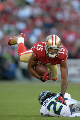 Michael Crabtree flies over a Seattle defender.