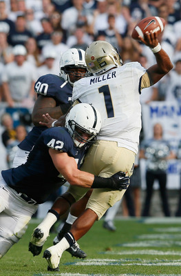 STATE COLLEGE, PA - SEPTEMBER 15: Quarterback Trey Miller #1 of the Navy Midshipmen gets off a pass while being hit by linebacker Michael Mauti #42 of the Penn State Nittany Lions during the first half at Beaver Stadium on September 15, 2012 in State Coll