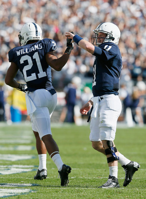 STATE COLLEGE, PA - SEPTEMBER 15: Quarterback  Matthew McGloin #11 of the Penn State Nittany Lions celebrates after throwing a touchdown pass with teammate Trevor Williams #21 during the first quarter against the Navy Midshipmen at Beaver Stadium on Septe