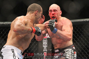 Dos Santos pummeled Carwin for a length of time before lightening up on him. Photo c/o MMAWeekly.com.