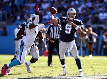 CHARLOTTE, NC - OCTOBER 21:  Tony Romo #9 of the Dallas Cowboys drops back to pass against the Carolina Panthers at Bank of America Stadium on October 21, 2012 in Charlotte, North Carolina.  (Photo by Streeter Lecka/Getty Images)
