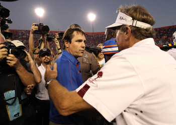 October 20, 2012; Gainesville FL, USA; Florida Gators head coach Will Muschamp and South Carolina Gamecocks head coach Steve Spurrier greet after the game during the second half at Ben Hill Griffin Stadium. Florida Gators defeated the South Carolina Gamec