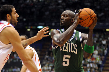 MILAN, ITALY - OCTOBER 07:  Kevin Garnett # 5 of Celtics  competes with Ioannis Bourousis # 15 of Armani during the NBA Europe Live game between EA7 Emporio Armani Milano v Boston Celtics at Mediolanum Forum  on October 7, 2012 in Milan, Italy.  (Photo by