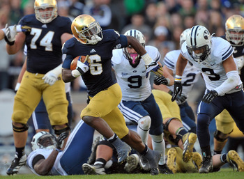 Oct. 20, 2012; South Bend, IN, USA; Notre Dame Fighting Irish running back Theo Riddick (6) runs the ball as BYU Cougars linebacker Kyle Van Noy (3) pursues in the third quarter at Notre Dame Stadium. Notre Dame won 17-14. Mandatory Credit: Matt Cashore-U