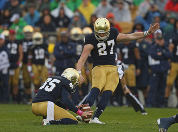 SOUTH BEND, IN - OCTOBER 13: Kyle Brindza #27 of the Notre Dame Fighting Irish kicks a field goal out of the hold of Ben Turk #35 against the Standford Cardinal at Notre Dame Stadium on October 13, 2012 in South Bend, Indiana. (Photo by Jonathan Daniel/Ge