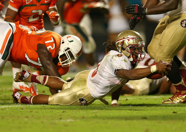 MIAMI GARDENS, FL - OCTOBER 20:  Devonta Freeman #8 of the Florida State Seminoles rushes during a game against the Miami Hurricanes at Sun Life Stadium on October 20, 2012 in Miami Gardens, Florida.  (Photo by Mike Ehrmann/Getty Images)