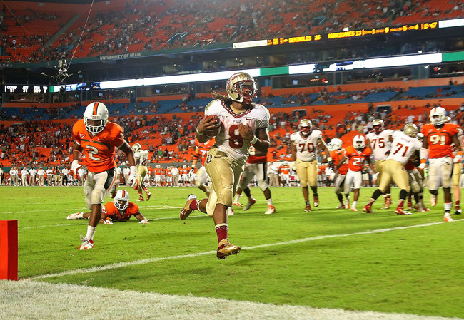 MIAMI GARDENS, FL - OCTOBER 20:  Devonta Freeman #8 of the Florida State Seminoles rushes for a touchdown during a game against the Miami Hurricanes at Sun Life Stadium on October 20, 2012 in Miami Gardens, Florida.  (Photo by Mike Ehrmann/Getty Images)