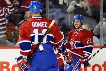 Montreal Canadiens Brian Gionta (right) and Scott Gomez.