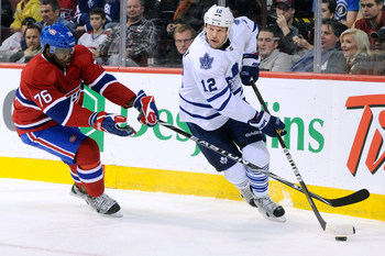 P.K. Subban of the Montreal Canadiens covers Tim Connolly of the Toronto Maple Leafs.