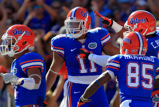 GAINESVILLE, FL - OCTOBER 20:  Tight End Jordan Reed #11 of the Florida Gators is celebrates his touchdown in the first quarter with wide receiver Frankie Hammond #85 of the Florida Gators and tight end Clay Burton #88 of the Florida Gators at Ben Hill Gr