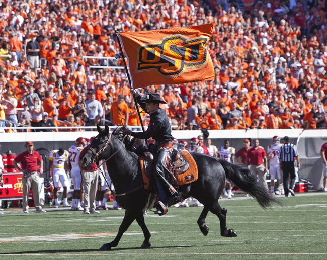 Oct 20, 2012; Stillwater OK, USA; Oklahoma State Cowboys mascot Bullet and spirit rider during the first quarter against the Iowa State Cyclones at Boone Pickens Stadium.  Mandatory Credit: Richard Rowe-US PRESSWIRE