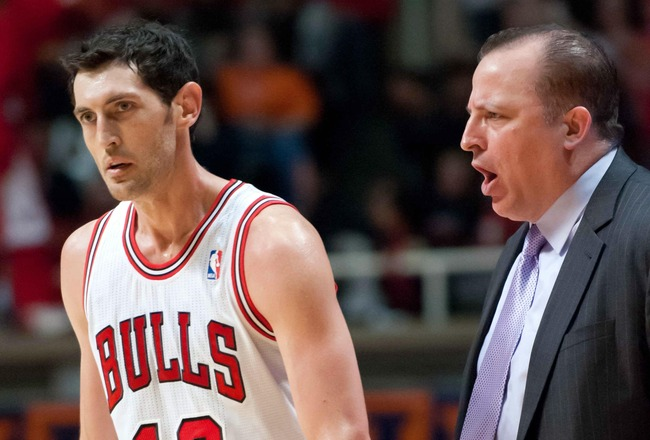 Oct 12, 2012; Champaign, IL, USA;  Chicago Bulls head coach Tom Thibodeau talks to guard Kirk Hinrich (12) during the third quarter against the Cleveland Cavaliers at Assembly Hall. Mandatory Credit: Bradley Leeb-US PRESSWIRE
