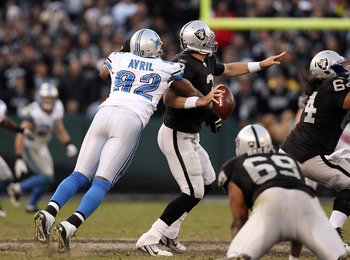 OAKLAND, CA - DECEMBER 18:  Cliff Avril #92 of the Detroit Lions sacks Carson Palmer #3 of the Oakland Raiders in the final minute of their game at O.co Coliseum on December 18, 2011 in Oakland, California.  (Photo by Ezra Shaw/Getty Images)