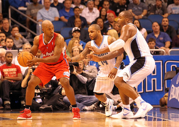 Glen Davis and Jameer Nelson guard the Clippers' Chauncey Billups.