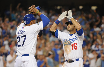 Matt Kemp and Andre Ethier rejoicing after a home run by Ethier against the Padres early in the season.