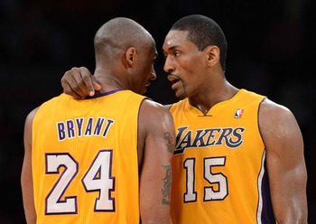 Metta World Peace (right) dislocated the middle finger of his right hand Sunday night.