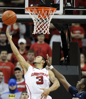 Feb 26, 2012; Louisville, KY, USA;  Louisville Cardinals guard Peyton Siva (3) shoots against Pittsburgh Panthers guard Ashton Gibbs (12) during the first half at the KFC Yum! Center.  Credit: Jamie Rhodes-US PRESSWIRE
