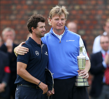 LYTHAM ST ANNES, ENGLAND - JULY 22:  New Open Champion Ernie Els of South Africa hugs with runner up Adam Scott of Australia after winning the 141st Open Championship at Royal Lytham & St. Annes Golf Club on July 22, 2012 in Lytham St Annes, England.  (Ph