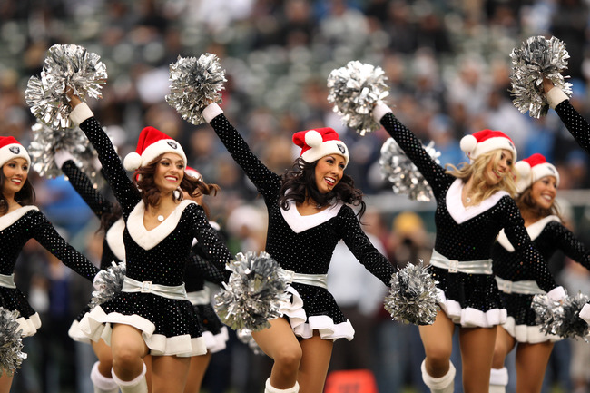 OAKLAND, CA - DECEMBER 18:  The Raiderette cheerleaders perform to the song Jingle Bells before the Oakland Raiders game against the Detroit Lions at O.co Coliseum on December 18, 2011 in Oakland, California.  (Photo by Ezra Shaw/Getty Images)