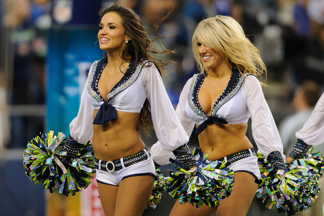 Sep 24, 2012; Seattle, WA, USA; The Seattle Seahawks sea gal cheerleaders perform during the two minute warning of the first half between the Seattle Seahawks and the Green Bay Packers at CenturyLink Field. Mandatory Credit: Steven Bisig-US PRESSWIRE