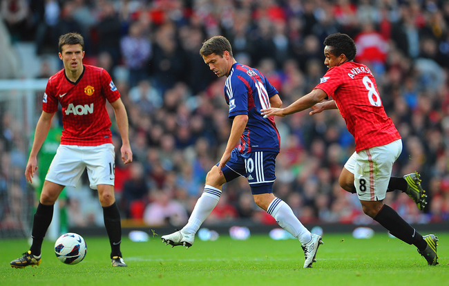 MANCHESTER, ENGLAND - OCTOBER 20: Michael Owen of Stoke in action with Michael Carrick and Anderson of Manchester United during the Barclays Premier League match between Manchester United and Stoke City at Old Trafford on October 20, 2012 in Manchester, E