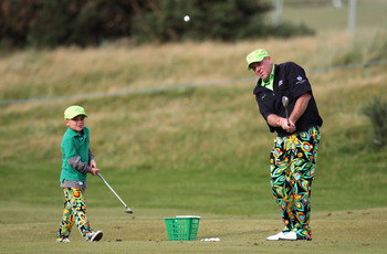 John Daly practices on his short game with his son.