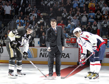 Mario Lemieux drops puck for Ovechkin and Malkin in ceremonial faceoff.