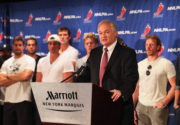 Donald Fehr addresses the media.