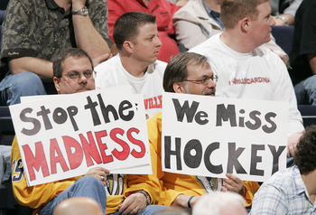 Two hockey fans express their sadness over the lost NHL season at a Florida Gators college basketball game.