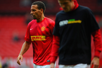 MANCHESTER, ENGLAND - OCTOBER 20: Rio Ferdinand of Manchetser United warms up as Michael Carrick wears a t-shirt for the Kick It Out campaign before the Barclays Premier League match between Manchester United and Stoke City at Old Trafford on October 20,