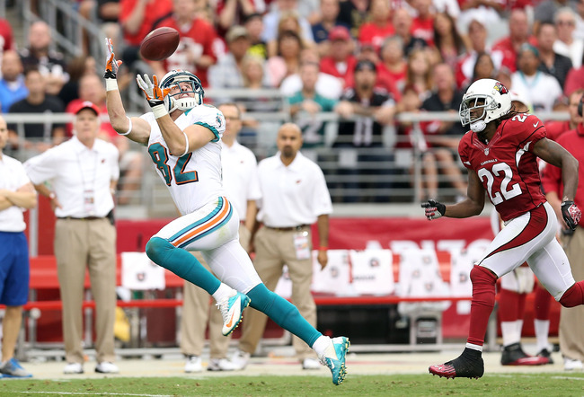 GLENDALE, AZ - SEPTEMBER 30:  Wide receiver Brian Hartline #82 of the Miami Dolphins catches a 57 yard reception past cornerback William Gay #22 of the Arizona Cardinals during the second quarter of the NFL game at the University of Phoenix Stadium on Sep