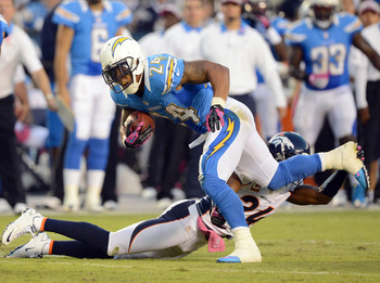 SAN DIEGO, CA - OCTOBER 15:  Ryan Mathews #24 of the San Diego Chargers is taken down by  Champ Bailey #24 of the Denver Broncos during the first quarter at Qualcomm Stadium on October 15, 2012 in San Diego, California.  (Photo by Harry How/Getty Images)