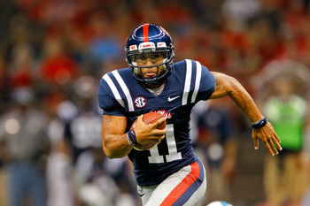 September 22, 2012; New Orleans, LA, USA; Ole Miss Rebels quarterback Barry Brunetti (11) runs against the Tulane Green Wave during a game at the Mercedes-Benz Superdome. Ole Miss defeated Tulane 39-0. Mandatory Credit: Derick E. Hingle-US PRESSWIRE