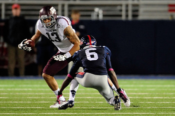OXFORD, MS - OCTOBER 06:  Mike Evans #13 of the Texas A&M Aggies tries to avoid Desmond Gardiner #6 of the Ole Miss Rebels during a game at Vaught-Hemingway Stadium on October 6, 2012 in Oxford, Mississippi.  (Photo by Stacy Revere/Getty Images)