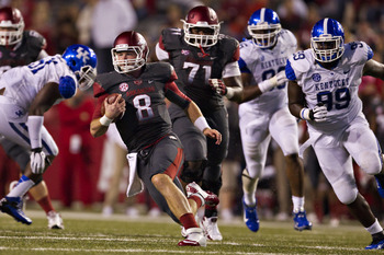 FAYETTEVILLE, AR - OCTOBER 13:  Tyler Wilson #8 of the Arkansas Razorbacks runs the ball against the Kentucky Wildcats at Razorback Stadium on October 13, 2012 in Fayetteville, Arkansas.  (Photo by Wesley Hitt/Getty Images)