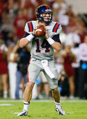 TUSCALOOSA, AL - SEPTEMBER 29: Bo Wallace #14 of the Mississippi Rebels steps back in the pocket against the Alabama Crimson Tide at Bryant-Denny Stadium on September 29, 2012 in Tuscaloosa, Alabama.  (Photo by Kevin C. Cox/Getty Images)