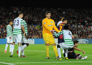 Ambrose helped to his feet by Fraser Forster.