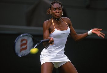 Venus defeats rival Martina Hingis for the first time at a Grand Slam, in the 2000 Wimbledon tournament.